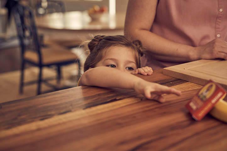 Little girl reaching for Sun-Maid raisins